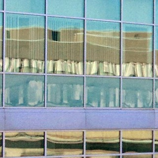 Math building distorted reflection in windows of EIT building