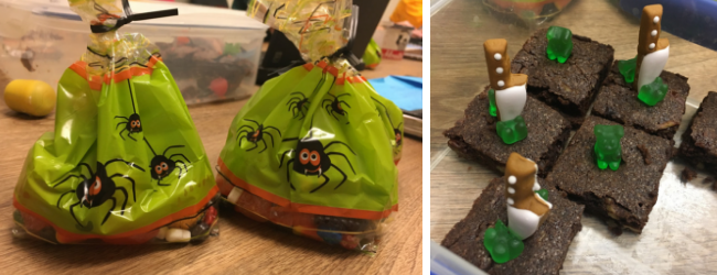 Halloween-themed cellophane bags of candy, and chocolate brownies with green gummy bears on top.